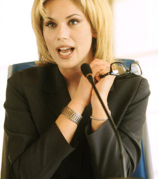 01 Sep 2000 --- Businesswoman Giving a Speech --- Image by © SIE Productions/CORBIS